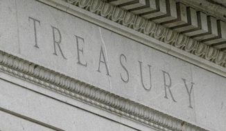 FILE - This May 4, 2021 file photo shows the Treasury Building in Washington. The U.S. Treasury Department said Thursday, May 20, 2021 that it supports a global minimum corporate tax rate of at least 15% — below the 21% minimum it has been seeking to impose on the foreign profits of U.S.-based companies. (AP Photo/Patrick Semansky, file)