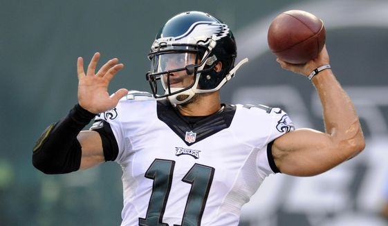 FILE - In this Sept. 3, 2015, file photo, Philadelphia Eagles quarterback Tim Tebow throws a pass before a preseason NFL football game against the New York Jets in East Rutherford, N.J. Tebow and coach Urban Meyer are together again, this time in the NFL and with Tebow playing a new position. The former Florida star and 2007 Heisman Trophy-winning quarterback signed a one-year contract with the Jacksonville Jaguars on Thursday, May 20, 2021, and will attempt to revive his pro career as a tight end. (AP Photo/Bill Kostroun, FIle)