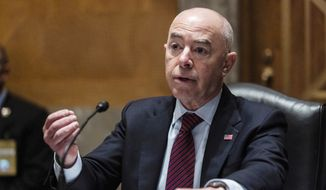 In this  Thursday, May 13, 2021, file photo, Homeland Security Secretary Alejandro Mayorkas testifies before a Senate Homeland Security and Government Affairs Committee hearing on Capitol Hill, in Washington. (Graeme Jennings/Pool via AP, File)
