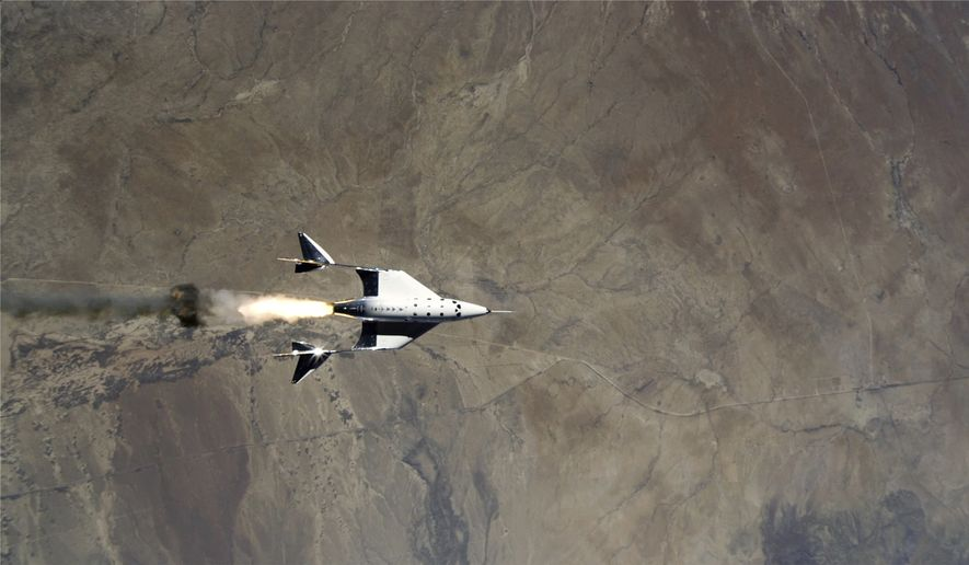 This Saturday, May 22, 2021, image provided by Virgin Galactic shows the release of VSS Unity from VMS Eve and ignition of rocket motor over Spaceport America, N.M. Virgin Galactic completed its third spaceflight and the first ever spaceflight from Spaceport America, N.M.  (Virgin Galactic via AP)