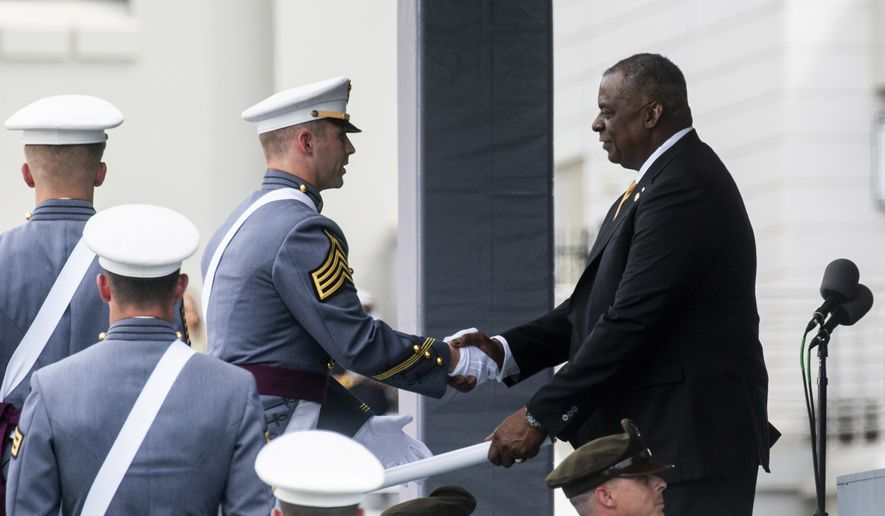 U.S. Defense Secretary Lloyd Austin hands out diplomas to United States Military Academy graduating cadets during the ceremony for class 2021 at Michie Stadium on Saturday, May 22, 2021, in West Point, N.Y. (AP Photo/Eduardo Munoz Alvarez)