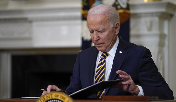 In this Feb. 24, 2021, file photo, President Joe Biden closes the folder after signing an executive order relating to U.S. supply chains, in the State Dining Room of the White House in Washington. (AP Photo/Evan Vucci, File)