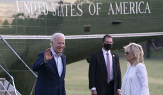 President Joe Biden, with first lady Jill Biden, waves as they walk from Marine One upon arrival on the Ellipse at the White House, Sunday, May 23, 2021, in Washington. Biden is returning from Camp David. (AP Photo/Alex Brandon)