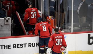 Washington Capitals defenseman Zdeno Chara (33), left wing Alex Ovechkin (8) and goaltender Ilya Samsonov (30) leave the ice after Game 5 of an NHL hockey Stanley Cup first-round playoff series against the Boston Bruins, Sunday, May 23, 2021, in Washington. The Bruins won 3-1. (AP Photo/Nick Wass) **FILE**