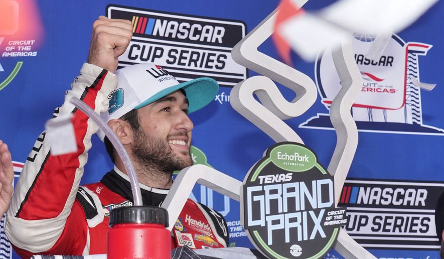 Chase Elliott celebrates in Victory Lane after winning a NASCAR Cup Series auto race at Circuit of the Americas in Austin, Texas, Sunday, May 23, 2021. (AP Photo/Chuck Burton)