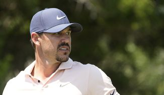 Brooks Koepka watches his shot from the second tee during the final round at the PGA Championship golf tournament on the Ocean Course, Sunday, May 23, 2021, in Kiawah Island, S.C. (AP Photo/David J. Phillip) **FILE**
