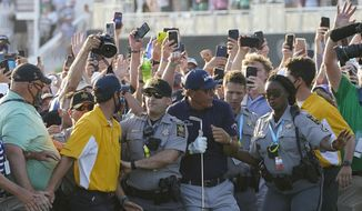 Phil Mickelson wades through fans on the 18th fairway during the final round at the PGA Championship golf tournament on the Ocean Course, Sunday, May 23, 2021, in Kiawah Island, S.C. (AP Photo/Matt York) **FILE**