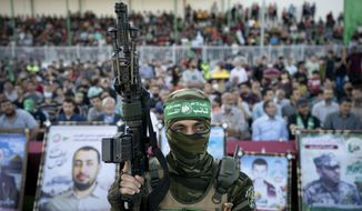 Militants stand guard around the stage as Yahya Sinwar, the Palestinian leader of Hamas in the Gaza Strip, makes a rally appearance days after a cease-fire was reached following an 11-day war between Gaza's Hamas rulers and Israel, Monday, May 24, 2021, in Gaza City, the Gaza Strip. (AP Photo/John Minchillo)
