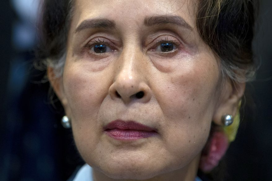 In this Dec. 11, 2019, file photo, Myanmar's leader Aung San Suu Kyi waits to address judges of the International Court of Justice on the second day of three days of hearings in The Hague, Netherlands. (AP Photo/Peter Dejong, File)