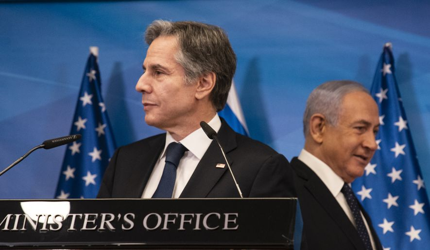 """U.S. Secretary of State Antony Blinken meets with Israeli Prime Minister Benjamin Netanyahu in Israel on Tuesday, May 25, 2021. Blinken said the U.S. would work to address the """"grave humanitarian situation"""" in the coastal territory but would also ensure that Gaza's militant Hamas rulers do not benefit from reconstruction assistance. (Associated Press)"""