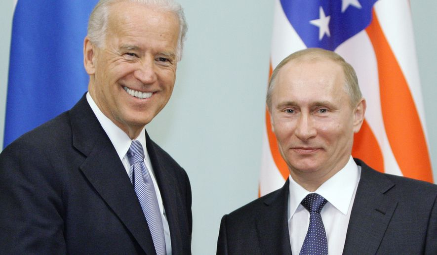 In this March 10, 2011, file photo, then-Vice President  Joe Biden, left, shakes hands with Russian Prime Minister Vladimir Putin in Moscow, Russia.  (RIA Novosti, Alexei Druzhinin/Pool via AP, File)