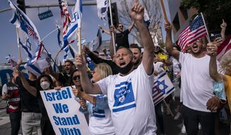 Pro-Israel supporters chant slogans during a rally in support of Israel outside the Federal Building in Los Angeles, Wednesday, May 12, 2021. A larger debate is playing out nationwide among many U.S. Jews who are divided over how to respond to the violence and over the disputed boundaries for acceptable criticism of Israeli policies. (AP Photo/Jae C. Hong, file)  **FILE**