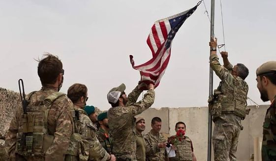 In this May 2, 2021, photo, a U.S. flag is lowered as American and Afghan soldiers attend a handover ceremony from the U.S. Army to the Afghan National Army at Camp Anthonic in the Helmand province of southern Afghanistan. The Taliban on Wednesday, May 26, 2021, warned the departing U.S. military against setting up bases in the region, and Pakistan vowed no American bases will be allowed on its territory. (Afghan Ministry of Defense Press Office via AP) ** FILE **