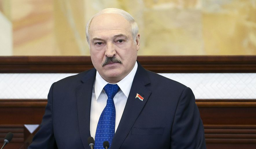 """Belarusian President Alexander Lukashenko addresses the Parliament in Minsk, Belarus, Wednesday, May 26, 2021. Lukashenko is defending his action to divert a European flight that triggered bruising European Union sanctions and accused the West of waging a """"hybrid war"""" to """"strangle"""" the ex-Soviet nation. On Sunday, May 23, 2021, Belarusian flight controllers ordered a Ryanair jetliner flying from Greece to Vilnius to land in the country's capital, Minsk because of a bomb threat and a Belarusian fighter jet was scrambled to escort the plane. (Sergei Shelega/BelTA Pool Photo via AP)"""