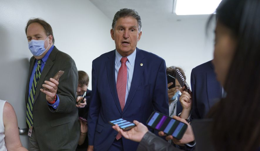Sen. Joe Manchin, D-W.Va., is surrounded by reporters as senators rush to the chamber for votes ahead of the approaching Memorial Day recess, at the Capitol in Washington, Wednesday, May 26, 2021. Lawmakers still face standoffs on an infrastructure bill, police reform, voting rights, and a bipartisan commission to investigate the Jan. 6 attack on the Capitol. (AP Photo/J. Scott Applewhite) **FILE**
