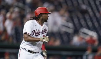 Washington Nationals' Josh Bell runs the bases on a home run during the ninth inning of the team's baseball game against the Cincinnati Reds in Washington, Tuesday, May 25, 2021. (AP Photo/Manuel Balce Ceneta) **FILE**