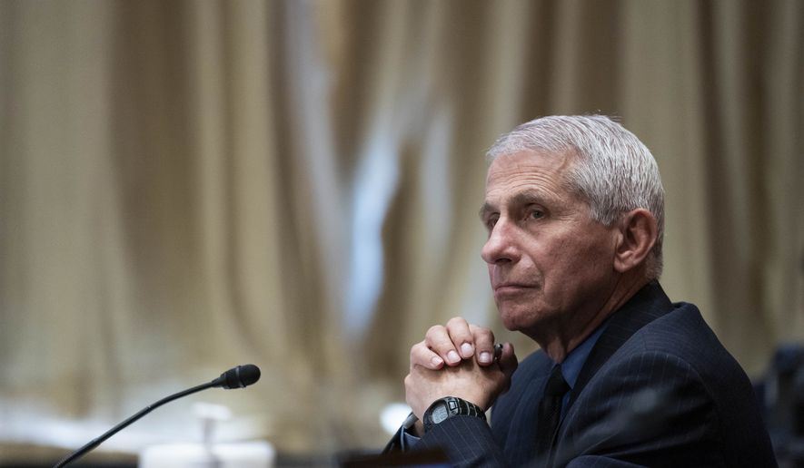 Dr. Anthony Fauci, director of the National Institute of Allergy and Infectious Diseases, listens during a Senate Appropriations Subcommittee looking into the budget estimates for National Institute of Health (NIH) and the state of medical research, Wednesday, May 26, 2021, on Capitol Hill in Washington. (Sarah Silbiger/Pool via AP) **FILE**