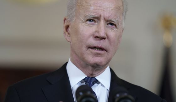 """In this Thursday, May 20, 2021, photo, President Joe Biden speaks in the Cross Hall of the White House in Washington. Biden is asking U.S. intelligence agencies to """"redouble"""" efforts to investigate the origins of the COVID-19 pandemic. He says there is insufficient evidence to conclude """"whether it emerged from human contact with an infected animal or from a laboratory accident."""" (AP Photo/Evan Vucci) **FILE**"""
