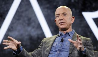 In this June 6, 2019, file photo, Amazon CEO Jeff Bezos speaks at the Amazon re:MARS convention, in Las Vegas. (AP Photo/John Locher) ** FILE **
