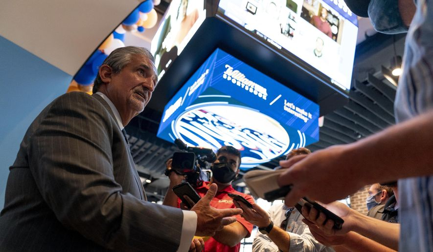 In this file photo, Ted Leonsis, Founder & CEO, Monumental Sports & Entertainment and owner of the Washington Wizards and the Washington Capitals speaks to reporters at a ribbon cutting for the William Hill Sportsbook at Monumental Sports & Entertainment's Capital One Arena in Washington, Wednesday, May 26, 2021. On July 7, Monumental announced it was created non-fungible tokens (NFTs) for both the Capitals and the Wizards.  (AP Photo/Andrew Harnik) **FILE**