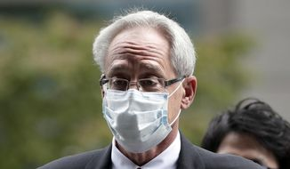 In this Sept. 15, 2020, file photo, former Nissan Motor Co. executive Greg Kelly arrives for the first trial hearing at the Tokyo District Court in Tokyo. Former Nissan chairman Carlos Ghosn has backed his former colleague American lawyer Kelly's insistence on his innocence of any wrongdoing. (Kiyoshi Ota/Pool Photo via AP, File)
