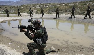 Afghan soldiers patrol outside their military base on the outskirts of Kabul, Afghanistan, Sunday, May 9, 2021. By Sept. 11 2021, at the latest, the remaining U.S.and allied NATO forces will leave Afghanistan, ending nearly 20 years of military engagement. Also leaving is the American air support that the Afghan military has relied on to stave off potentially game-changing Taliban assaults, ever since it took command of the war from the U.S. and NATO in 2014. (AP Photo/Rahmat Gul) **FILE**