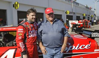 NASCAR driver Tony Stewart, left, and retired race driver, A.J. Foyt pose in the garage area during practice for the Daytona 500 auto race at the Daytona International Speedway in Daytona Beach, Fla., in this Friday, Feb. 13, 2009, file photo. Tony Stewart idolized A.J. Foyt as a child and wanted nothing more than to become the same type of racer as Super Tex. They built a decades-long friendship and will spend Sunday together at Indianapolis Motor Speedway celebrating the 60th anniversary of the first of Foyts four Indianapolis 500 victories.(AP Photo/John Raoux, File) **FILE**