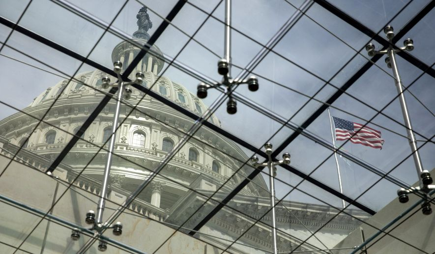 In this April 29, 2021, file photo, the dome of the U.S. Capitol is seen through a glass ceiling in Washington. (AP Photo/Amanda Andrade-Rhoades, File)