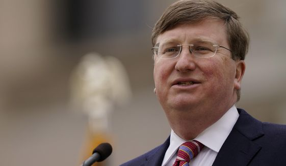 FILE - Mississippi Republican Gov. Tate Reeves speaks during his State of the State speech on Tuesday, Jan. 26, 2021, on the south steps of the state Capitol in Jackson, Miss. Some Mississippi lawmakers say they want Gov. Reeves to call them back to the Capitol for a special session to revive the state's initiative process. Others want a chance to quickly revive discussion of a medical marijuana program. (AP Photo/Rogelio V. Solis, file)