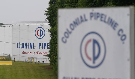 In this May 12, 2021, file photo, the entrance of Colonial Pipeline Company in Charlotte, N.C. U.S. pipeline operators will be required for the first time to conduct a cybersecurity assessment under a Biden administration directive to be issued Thursday in response to the ransomware hack that disrupted gas supplies in several states this month. (AP Photo/Chris Carlson, File)
