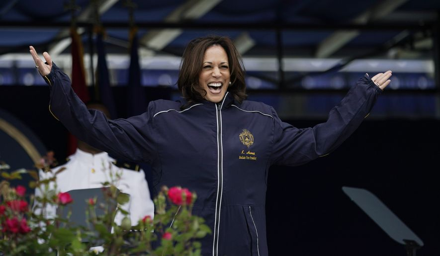 Vice President Kamala Harris displays her U.S. Naval Academy jacket at the graduation and commission ceremony at the U.S. Naval Academy in Annapolis, Md., Friday, May 28, 2021. Harris is the first woman to give the graduation speech at the Naval Academy. (AP Photo/Julio Cortez)