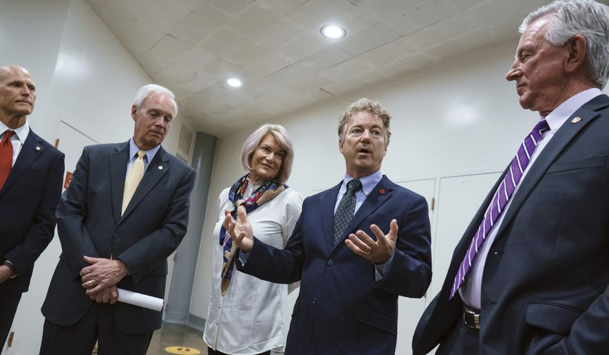 GOP senators, from left, Sen. Rick Scott, R-Fla., Sen. Ron Johnson, R-Wis., Sen. Cynthia Lummis, R-Wyo., Sen. Rand Paul, R-Ky., and Sen. Tommy Tuberville, R-Ala., talk to reporters as the Senate tries to finish to its work going into the Memorial Day recess, at the Capitol in Washington, Friday, May 28, 2021. Republican leaders are insisting they will block a commission on the Jan. 6 insurrection by a mob loyal to former President Donald Trump. (AP Photo/J. Scott Applewhite)