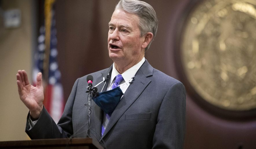 """In this Oct. 1, 2020, file photo, Idaho Gov. Brad Little gestures during a press conference at the Statehouse in Boise, Idaho. Gov. Little has issued an executive order repealing a mask-mandate prohibition put in place while he was out of the state by the lieutenant governor, describing her actions as a tyrannical abuse of power and an """"irresponsible, self-serving political stunt."""" The Republican governor on Friday, May 28, 2021, rescinded Republican Lt. Gov. Janice McGeachin's executive action taken Thursday. (Darin Oswald/Idaho Statesman via AP, File)"""