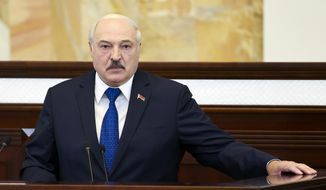 """In this Wednesday, May 26, 2021, file photo, Belarusian President Alexander Lukashenko addresses Parliament in Minsk, Belarus. Lukashenko defended the diversion of a commercial flight carrying dissident journalist Raman Pratasevich to Minsk, where he was arrested on Sunday, May 23, 2021. The diversion triggered bruising European Union sanctions and Lukashenko accused the West of trying to """"strangle"""" his country. (Sergei Shelega/BelTA Pool Photo via AP)"""