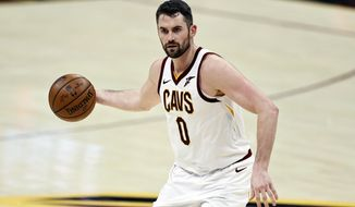 In this April 30, 2021, file photo, Cleveland Cavaliers' Kevin Love (0) dribbles against the Washington Wizards during the first half of an NBA basketball game in Cleveland. (AP Photo/Ron Schwane, File)
