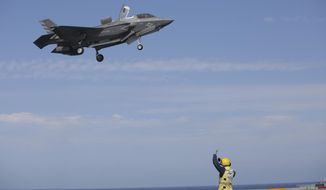 Military personnel guide an American F-35 during the NATO Steadfast Defender 2021 exercises on board the aircraft carrier HMS Queen Elizabeth off the coast of Portugal, Thursday, May 27, 2021. NATO has helped provide security in Afghanistan for almost two decades but the government and armed forces in the conflict-torn country are strong enough to stand on their own feet without international troops to back them, the head of the military organization said Thursday. (AP Photo/Ana Brigida)