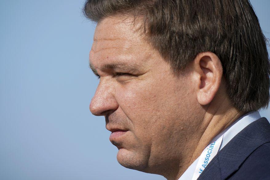 In this Saturday, May 8, 2021, file photo, Florida Gov. Ron DeSantis watches the foursome matches during the Walker Cup golf tournament, in Juno Beach, Fla. (AP Photo/Brynn Anderson) ** FILE **