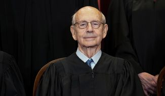 FILE - In this April 23, 2021, file photo, Supreme Court Associate Justice Stephen Breyer sits during a group photo at the Supreme Court in Washington. Breyer is talking with the head of the National Constitution Center in Philadelphia and taking questions from students on Friday, May 28. (Erin Schaff/The New York Times via AP, Pool)