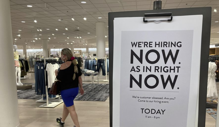 A customer walks behind a sign at a Nordstrom store seeking employees, Friday, May 21, 2021, in Coral Gables, Fla. (AP Photo/Marta Lavandier) ** FILE **