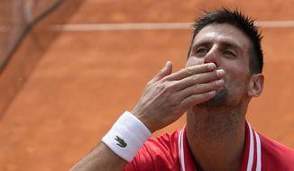 Novak Djokovic of Serbia celebrates after their final tennis match of the Belgrade Open tennis tournament against Alex Molcan of Slovakia, in Belgrade, Serbia, Saturday, May 29, 2021. (AP Photo/Darko Vojinovic)