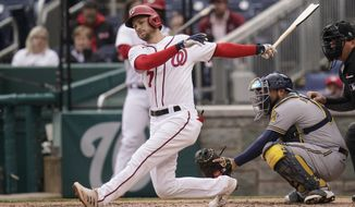 Washington Nationals' Trea Turner breaks his bat while hitting an infield single against the Milwaukee Brewers during the sixth inning of a baseball game, Sunday, May 30, 2021, in Washington. (AP Photo/Julio Cortez)