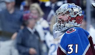 Colorado Avalanche goaltender Philipp Grubauer (31) is seen after a win against the Vegas Golden Knights in Game 1 of an NHL hockey Stanley Cup second-round playoff series Sunday, May 30, 2021, in Denver. (AP Photo/Jack Dempsey) **FILE**