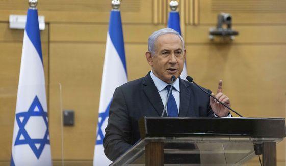 Israeli Prime Minister Benjamin Netanyahu speaks to the Israeli Parliament in Jerusalem, Sunday, May 30, 2021. (Yonatan Sindel/Pool via AP)