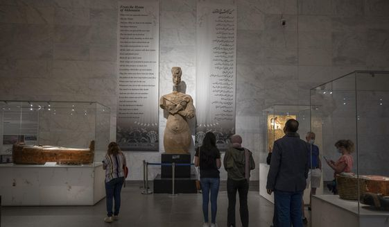 In this April 24, 2021, file photo, people visit the new National Museum of Egyptian Civilization in Old Cairo. As some European countries reopen to international tourists, Egypt has already been trying for months to attract them to its archaeological sites and museums. Officials are betting that the new ancient discoveries will set it apart on the mid- and post-pandemic tourism market. (AP Photo/Nariman El-Mofty, File)