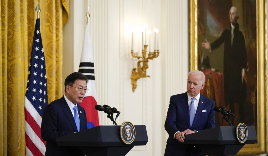"""In this May 21, 2021, file photo, President Joe Biden listens as South Korean President Moon Jae-in speaks during a joint news conference in the East Room of the White House, in Washington. North Korea said Monday, May 31, the U.S. allowing South Korea to build more powerful missiles was an example of the U.S.'s hostile policy against the North, warning that it could lead to an """"acute and instable situation"""" on the Korean Peninsula. (AP Photo/Alex Brandon, File)"""