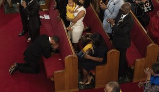 The Rev. John R. Faison Sr. kneels in prayer after preaching at a joint service for the centennial of the Tulsa Race Massacre at First Baptist Church of North Tulsa, Sunday, May 30, 2021, in Tulsa, Okla. (AP Photo/John Locher)