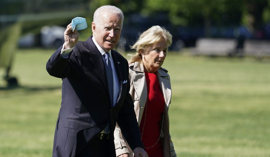 President Joe Biden, with first lady Jill Biden, waves as they walk from Marine One upon arrival on the Ellipse at the White House, Monday, May 31, 2021, in Washington. (AP Photo/Alex Brandon)