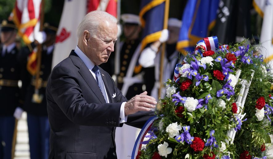 President Joe Biden places a wreath at the Tomb of the Unknown Soldier at Arlington National Cemetery on Memorial Day, Monday, May 31, 2021, in Arlington, Va.(AP Photo/Alex Brandon)