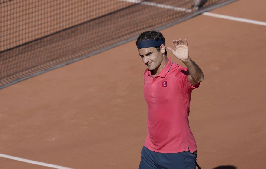 Switzerland's Roger Federer waves to the crowd after defeating Uzbekistan's Denis Istomin during their first round match on day two of the French Open tennis tournament at Roland Garros in Paris, France, Monday, May 31, 2021. (AP Photo/Thibault Camus)
