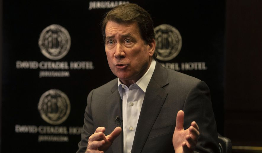 U.S. Sen. Bill Hagerty gestures as he speaks during an interview with The Associated Press in Jerusalem, Monday, May 31, 2021. (AP Photo/Sebastian Scheiner) ** FILE **